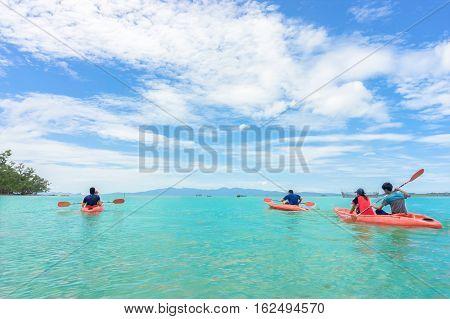 Kayaks. Kayaking. People kayaking into the sea.