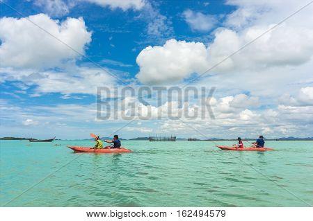 Kayaks. kayaking. People kayaking in the sea.