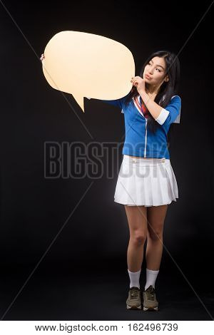 Asian woman posing with blank poster for expressing your ideas or emotions isolated on grey background in studio.