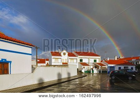 Vila Nova de Milfontes, Portugal, November 24, 2016: A rainbow over Vila Nova de Milfontes in Portugal.