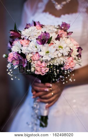 the bride holding a bouquet of white pink and mauve flowers women's hands and a bouquet of flowers the morning of the bride wedding flowers