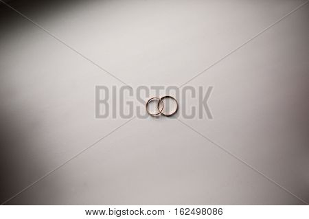 infinity sign of the rings wedding rings on a white backgroundwedding bands