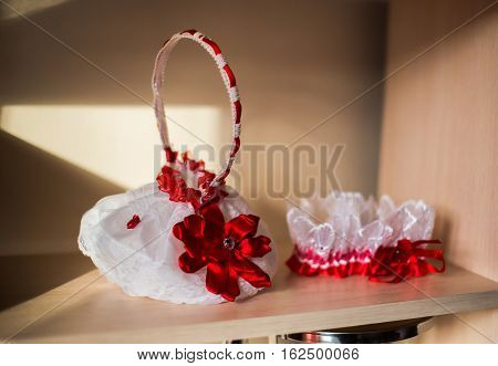 bride's garter with red bow bridal accessories bride morning bride fees preparation for the wedding