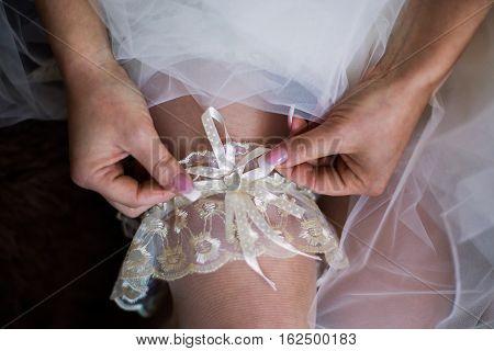 white garter on leg of the bride morning bride the bride wears a garter on the leg the preparations for the wedding