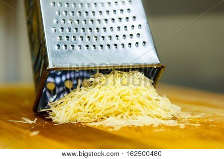 Parmesan cheese grated for pasta is on the Board