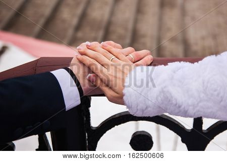 Bride and groom with rings on their hands male and female hand with wedding rings wedding ceremony together forever