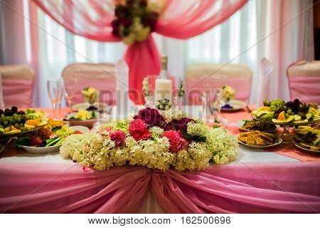 white and purple flowers wedding accessories wedding preparation decorated wedding table with flowers wedding flowers wedding bouquet food on the table decorated chairs table and chairs glasses fruit grapes salad on the table