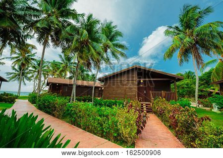Cayo Guillermo island, Sercotel resort, Cuba, July 4, 2016, beautiful inviting gorgeous view of a bungalow house standing above the ground in front of the beach with ocean view on slightly cloudy day