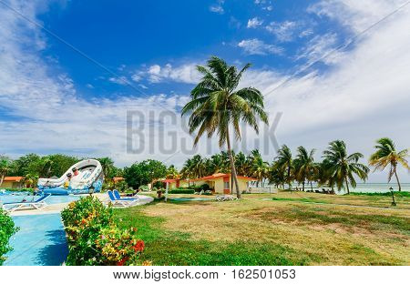 Cayo Guillermo island, Sercotel resort, Cuba, July 4, 2016, nice amazing gorgeous landscape view of hotel grounds with swimming pool and people relaxing and enjoying their time on sunny day