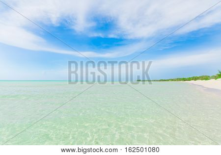 Cayo Coco island, Cuba, amazing stunning beautiful view of tranquil turquoise ocean, beach against magic mesmerizing blue sky background on sunny day