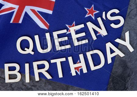 Queen's Barthday signage on the New Zealand flag.