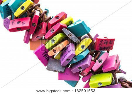 Colorful lock with messages written in Thailand on the white background.