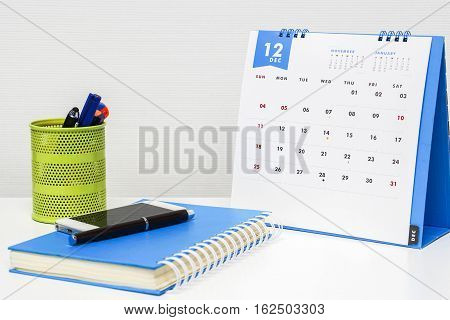 December calendar on office desk ready for appointment and business meeting