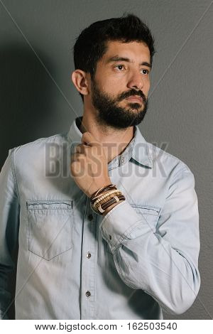 Advertising Leather Bracelets Concept. Portrait Of Young Man Wearing Leather Bracelets And Wrist Wat