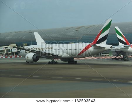 DUBAI, UAE - NOV 28: Emirates Airlines at Dubai International Airport, one of the busiest airports, as seen on Nov 28, 2016. It is a major airline hub in the Middle East, and is the main airport of Dubai.