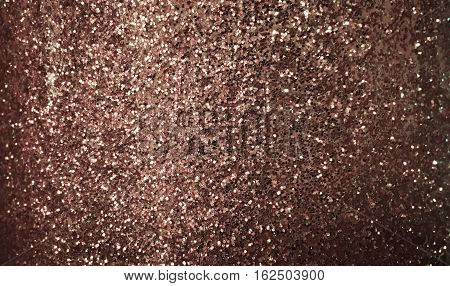 dark rose gold glitter texture background for design
