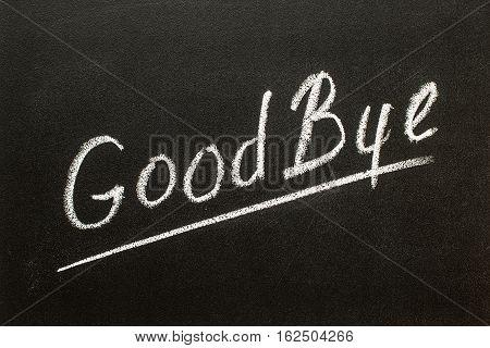 Goodbye hand writing chalk text on black chalkboard