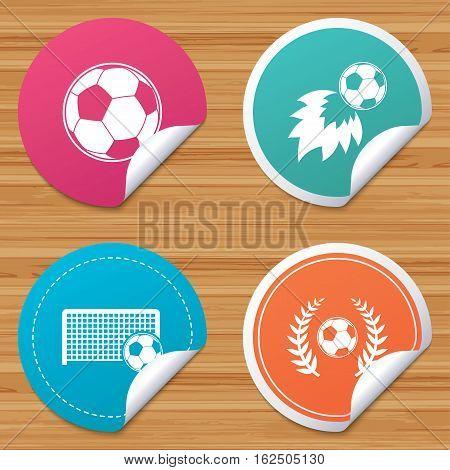 Round stickers or website banners. Football icons. Soccer ball sport sign. Goalkeeper gate symbol. Winner award laurel wreath. Goalscorer fireball. Circle badges with bended corner. Vector