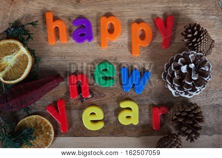 Happy New Year Magnet Letters Concept on old wooden background
