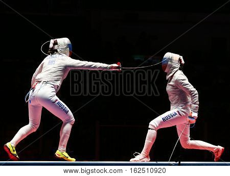 RIO DE JANEIRO, BRAZIL - AUGUST 8, 2016: Sofya Velikaya (L) and Yana Egorian of Russia in action during final in the Women's individual sabre of the Rio 2016 Olympic Games at the Carioca Arena 3