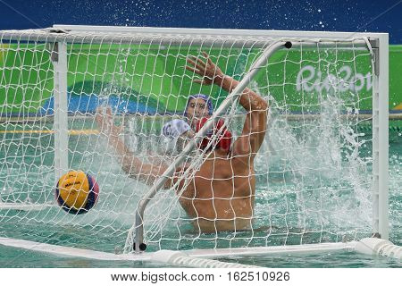 RIO DE JANEIRO, BRAZIL - AUGUST 10, 2016: Water Polo Team Hungary (in blue) scores during Rio Olympics Men's Preliminary Round Group A match against Team Greece at the Maria Lenk Aquatic Center