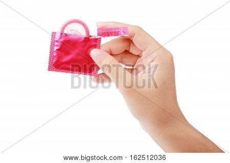 Condom in woman's hand ready for use isolated on a white background clipping path.