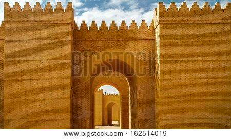 Gate of partially restored Babylon ruins Hillah Iraq