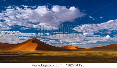 Deep shadows on Sossusvlei dunes at sunrise in Namib desert Namibia