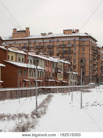 beautiful winter view of the house and terraced houses, snow-covered streets