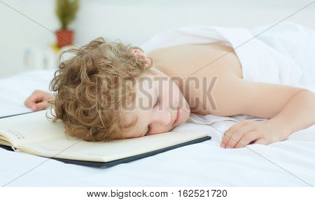 Boy fell asleep at the notebook.Education concept.