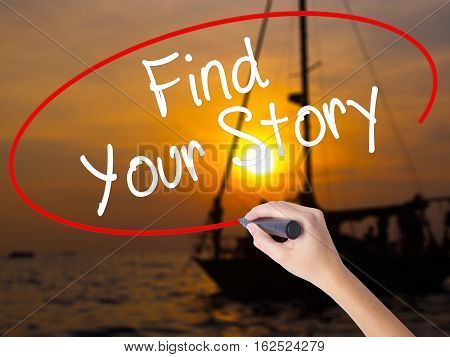 Woman Hand Writing Find Your Story With A Marker Over Transparent Board