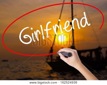 Woman Hand Writing Girlfriend With A Marker Over Transparent Board
