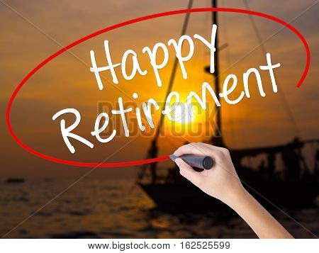 Woman Hand Writing Happy Retirement  With A Marker Over Transparent Board