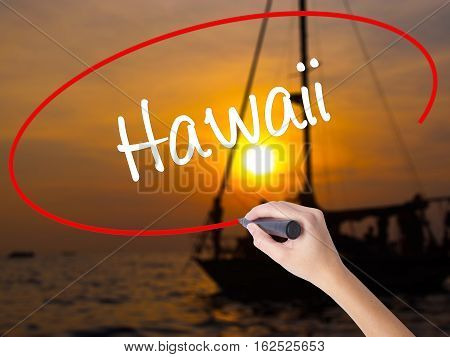 Woman Hand Writing Hawaii  With A Marker Over Transparent Board