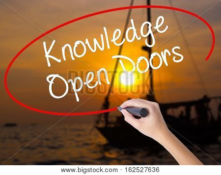 Woman Hand Writing  Knowledge Open Doors  With A Marker Over Transparent Board