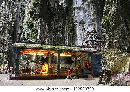 Kuala Lumpur Malaysia - July 7 2009: unnamed people at Hindu temple located in the Temple Cave at Batu Caves. Gombak Selangor Malaysia.