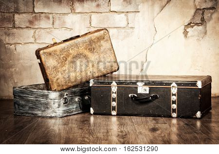 Suitcases on a background of red brick wall.