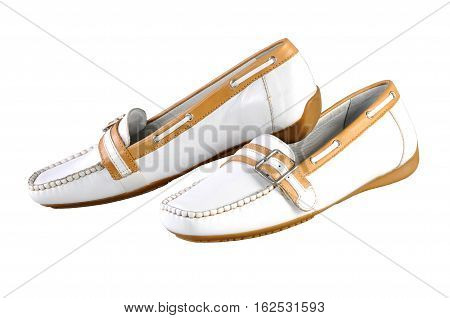classical style moccasin. Women's white leather loafers isolated on white background