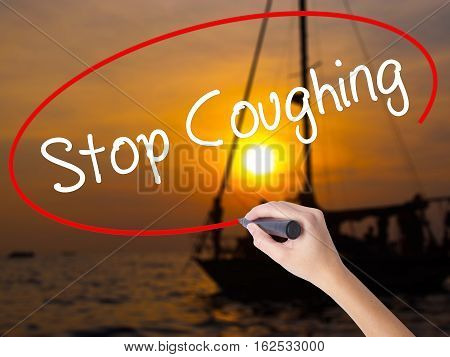 Woman Hand Writing Stop Coughing With A Marker Over Transparent Board