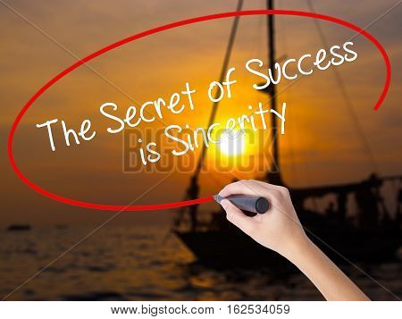 Woman Hand Writing The Secret Of Success Is Sincerity With A Marker Over Transparent Board.