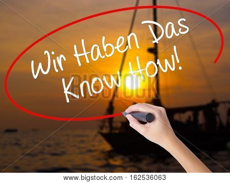 Woman Hand Writing Wir Haben Das Know How! (we Have The Know-how In German)  With A Marker Over Tran