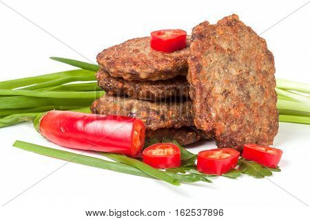 liver pancakes or cutlets with chili pepper and green onions isolated on white background.
