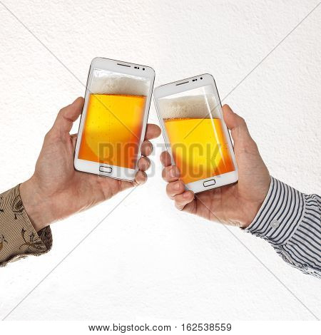 Two male hands in shirts hold smart phones with beer against white background. Concept of online connection and sharing cheers and drinking beer using cell phone connection