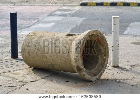 Closeup of a big concrete pipe on the street during reconstruction