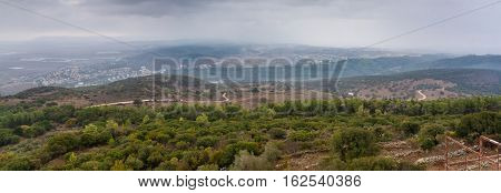 View of the Jezreel Valley in fog in winter cloudy day from Muhraqa on Mount Carmel in Lower Galilee Israel