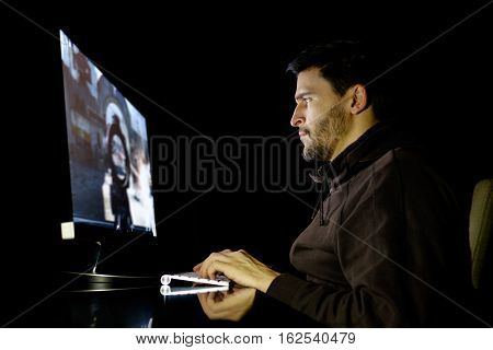 Handsome Male Gamer Playing Computer Video Game