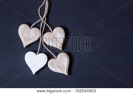 wooden hearts on a black wooden background