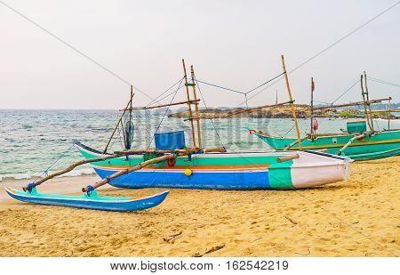Catamaran-boats On The Beach