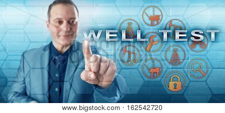 Smiling male petroleum engineer is pushing WELL TEST on an interactive control monitor. Gas and oil industry metaphor and fossil fuels concept for identifying the capacity of a petroleum reservoir.