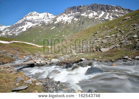 View of two summits (Grande Casse and Pierre Brune) from a torrent in Vanoise National Park, French Alps, France